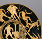 This cup, made about 430-440 BC, shows the deeds of the hero Theseus. In the centre picture, he has just killed the Minotaur.