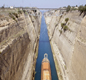 A photo of a ship passing through the Corinth Canal.