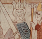 This picture shows a king with his council or witan. It also shows a man being hanged. It's from an Anglo-Saxon manuscript re-telling a Bible story.