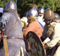 A battle between 'Anglo-Saxons' and 'Vikings'. It's staged by 're-enactors' (people who dress up and act out history).