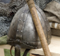 These are modern copies of Anglo-Saxon armour and helmets. Can you see the spear too?
