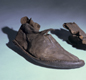 Anglo-Saxon shoes. They are made of leather, probably from a cow's skin.
