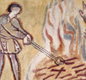 This picture shows a smith heating iron in a fire. Other men watch and warm their hands.