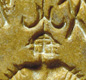 A square seal with a figure, probably an Indus god. He has three faces, a horned headdress, and lots of arm-bangles. <!-- Copyright J.M. Kenoyer/Harappa.com, Courtesy Dept. of Archaeology and Museums, Govt. of Pakistan -->