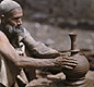 Indus Valley potters shaped clay pots on a wheel, like this one used by an Indian potter today.