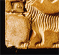 This seal shows a tiger with many stripes.  Tigers were common in the time of the Indus civilisation.