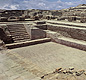 The Great Bath at Mohenjo-Daro. You can see the stairs leading down into the bath, and a ledge for people to stand on.