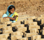This photo shows a child-worker at a brick-factory in India. Bricks have been made in India for thousands of years, since the Indus civilisation.