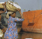 The rivers of India and Pakistan are still busy with ships and trade. These women in Karachi are loading salt into a barge.