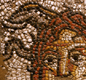 The snaky-haired head of Medusa. Part of a mosaic in a museum at Cirencester.