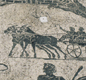 This mosaic from Italy shows a Roman driving a horse and cart.