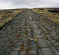 Bits of Roman road can still be seen. Soldiers and carts used this cobbled road (at Blackstone Edge in Lancashire) to travel between Mamucium (Roman for  Manchester) and Yorkshire.