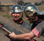 Modern 'Roman soldiers' show how an army catapult or 'onager' was fired. It threw rocks or balls of burning tar. 