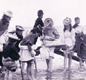 Girls paddling at Yarmouth in 1892. Seaside holidays became popular, thanks to the new railways.