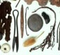 These are fragments of Viking cloth and weaving tools. The tools include needles and shears. The textiles still have traces of coloured dyes.