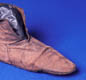 A leather boot. Can you see how it was fastened? This boot was found at Coppergate (York).
