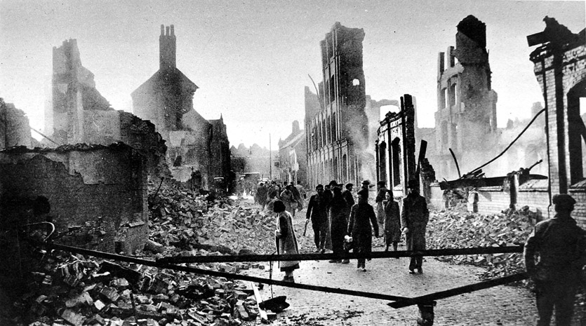 Photo of Coventry, after the air raid of 14 November 1940. People walk