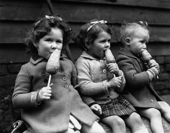 Not an ice lolly these children are eating carrots on sticks instead