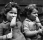 Not an ice lolly! These children are eating carrots on sticks, instead of ice creams, because of wartime rationing  