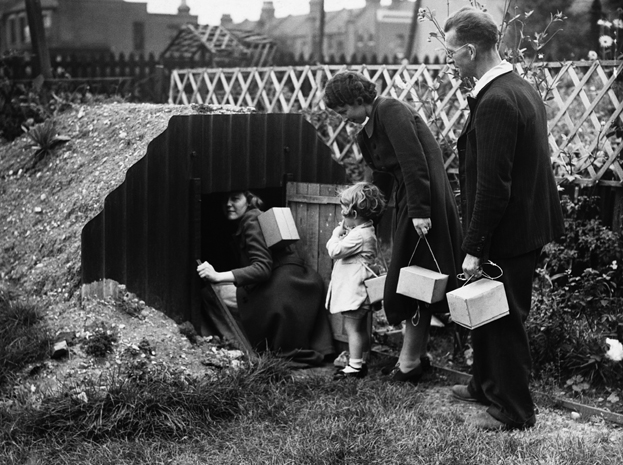family goes into an Anderson air raid shelter in their garden, 1939 ...