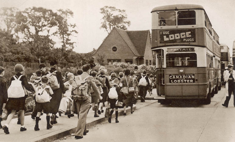 School children make their way to buses waiting to take them out of