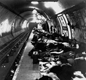 People sleeping on the platform of a London Underground railway station, in 1940.