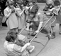 Nursery school children at play wearing their gas masks. This photo seems to suggest that wearing gas masks could be fun. The masks were not very nice to wear though.