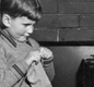 Two young boys knit for the troops.