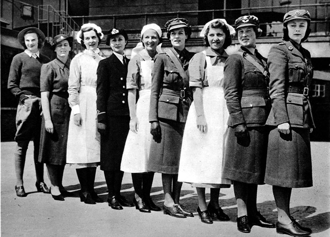 row of Harrods employees, each wearing the uniform of a different ...