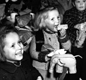 Orphans of victims of Nazi concentration camps receive handmade toys from various Berlin handicraft groups.