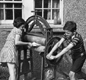 This photo of 'Peter' and 'Pam' using a mangle to dry the washing appeared in Picture Post magazine in 1941. Dad was away in the RAF, and the children were helping mum.