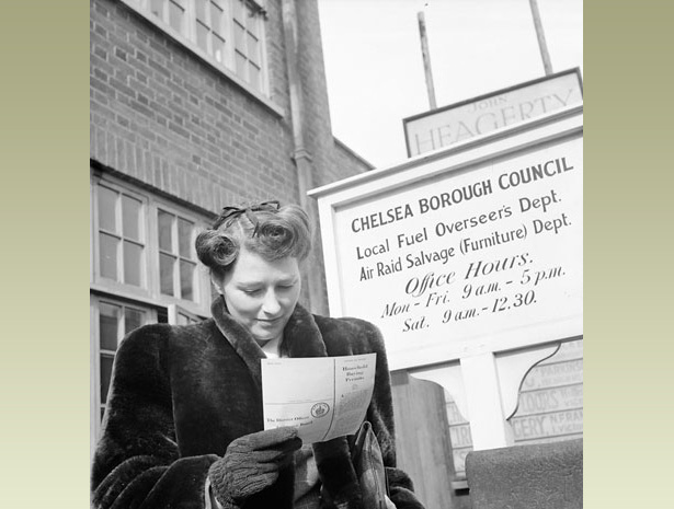 Woman reads a letter from her local council, telling her she can buy