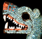 The double-headed snake was made by the Mexica between 1400 and 1500.  The red around the serpent's mouth is made of oyster shells. [© Trustees of the British Museum]