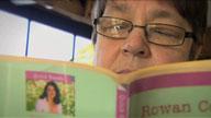 Photograph of Sue Chapman reading a novel