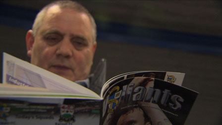 Reading the football programme