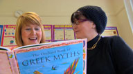 Photograph of students in a paired reading activity